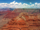 Flying In the blue sky, where the clouds reflect the Grand Canyon colors...