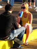 Young lovers at the Santa Monica pier: the life running behind, never stopping ...