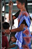 Safe under mother's sari