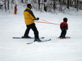And That's James, Pulling His Dad Down the Slope :-)