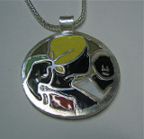 Three Women Pendant.JPG