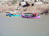 ...a group of raftersfloating down river