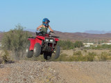 Kaelyn catches a little airon her ATV ...