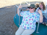 Grandma rides themerry-go-roundwith the girls ...