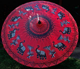 Large umbrella with elephants and bamboo