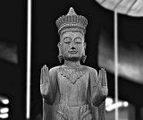 Carved wooden image of the Buddha