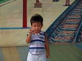 Boy posing in front of mural