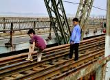 Boys stealing railroad spikes