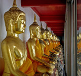 Row of Buddha images, close up