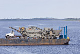Rock crusher heading out on barge