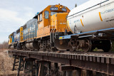 GP40-2 2200 and GP38-2 back across Butler Creek bridge on the way to Moosonee Airport 2010 April 30th