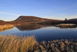 Giants face reflected in Dava Lochan
