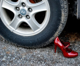 Red Shoe Under Tire