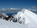 Skiers Returning to False Summit