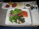 ANA flight: Appetisers - Spinach fritters and fresh garden salad with yoghurt-tamarind sauce. Potato and Indian cheese croquette