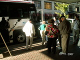 Joan and Dave Jordan board tour bus. Don Russell left in the light jacket.