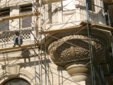 Detail of new Retro flats with workman thinking