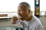 Enjoying a Beignet at Café DuMonde on the Riverwalk