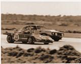 3rd Place Alfa Romeo 33TT3 of Vaccarella-Hezemans dwarfed by a Camara, 12Hrs Sebring 1972.jpg