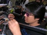 Aki at work on a Japanese torch, using very soft satake glass to make a bead. Look, you can't even see the flame...