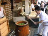 Downtown Osaka, watching live thumping of the mochi.  It was fun to watch them fly with those hammers, and more fun to eat!