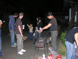 Aki, master grill chef, trying to get those coals going.  That's his wife Hiromi in the background, with his energetic youngest.