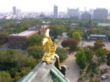 The golden fishhead with the city of Osaka beyond.