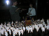 A miniaturized version of the procession, with Keith explaining it all to Becky on the other side.