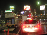 This is a famous view of Tokyo seen in many movies.  Well, not with a car's taillights like this...