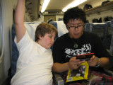 On the bullet train!  Guess what Brendon and Yoshio are playing...