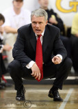 Maryland Terrapins Head Coach Gary Williams talks with his assistants as he watches the game