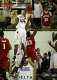 Yellow Jackets F Aminu blocks the layup attempt by Terrapins F Dino Gregory