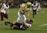 Jackets FB Mike Cox runs over Hokies LB Cam Martin