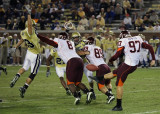 GT S Troy Garside leaps to attempt a block of a VT Brent Bowden punt