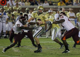Jackets QB Bennett is surrounded by the Hokies defense