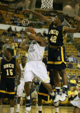 GT F Smith attempts a shot with UNCG F Kyle Hines defending