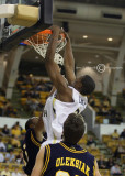 Tech F Gani Lawal dunks over the Spartans defense…