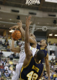 Jackets F Smith goes up strong against the Spartans defense