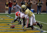 UGA PR Mikey Henderson recovers his muffed punt and is tackled by Tech S Morgan Burnett