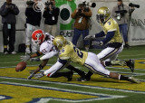 UGA PR Ramarcus Brown recovers his muffed punt while challenged by GT CB Dominique Reese