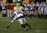 GT WR Greg Smith lets a pass slip through his hands as UGA SC Thomas Flowers makes the hit