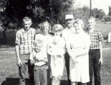 The original copy of this shot reads, Oct 1965. From left to right we can see, Roy Raymond, David Arthur, Donna Lou, JoAnne Esther, (holding Sharolynn Ann Macomber) Harold Everette, Harold Everett Robinson II, & Lucille Alena [Mattson] Robinson. This shot was donated by Harold's daughter, Amy Lynn [Robinson] Piar.