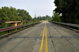 Old Bridge next to railroad tracks