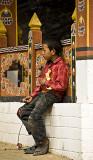 Boy at prayer wheel