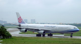 China Airline A-340 slowly taxi to its gate at SGN