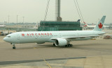 Air Canada's 777-300 taxi toward its gate at LHR T3