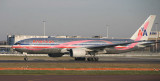 Pink AA B777 taking off from LHR Runway 27R