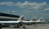 PEK terminal with the line up of the tails from various Chinese airlines