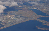 Aerial view of JFK, note on the left a plane is approaching RWY 31L