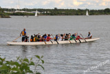 A Dragon Boat team training on a Lake Ontario Bay